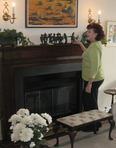 Katie cleaning the fireplace mantle